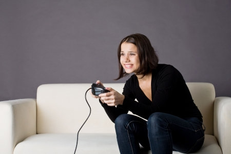 young woman playing video games photo