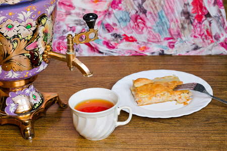 samovar: Vintage Russian samovar with a great cup of tea on a wooden background