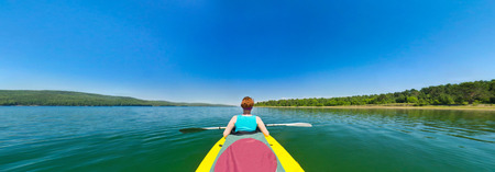 fish eye: girl in a kayak floating down the river. fish eye