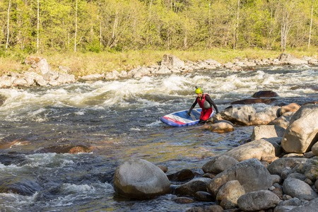 sup: The man fell from SUP surfing on the rapids of the mountain river Stock Photo