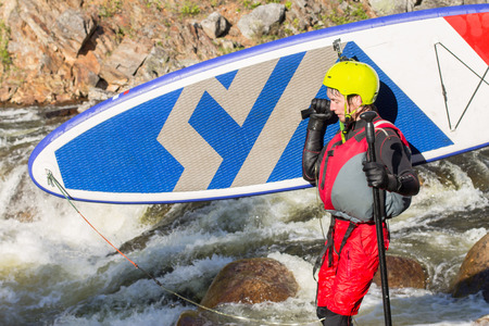 rapids: The man fell from SUP surfing on the rapids of the mountain river Stock Photo