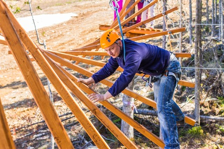clambering: The man climbs into ropes course