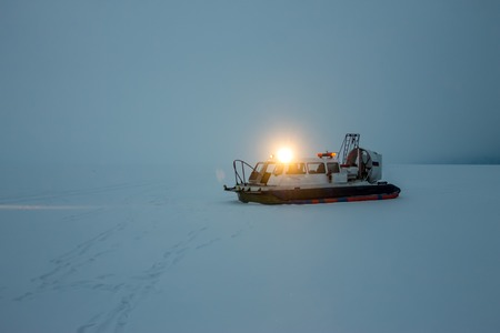 hovercraft: hovercraft stay in the fog and snow at Lake Baikal