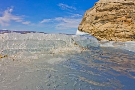baical: Blue ice of Lake Baikal, Olkhon Island and the Small Sea Strait Stock Photo