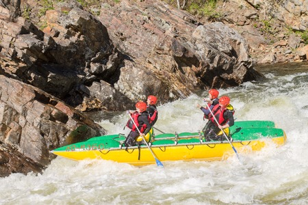doorstep: Khara-Murin, Russia - May 28. Rafting on the river Khara-Murin Langutay on the doorstep, the feast day of Whitewater May 28, 2016  Group of people floated on a catamaran and raft. Editorial