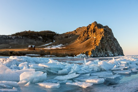 Ice hummocks on a background of lake depressions and at sunset Cape Uzury