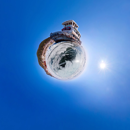 Old rusty ship on the coast of Lake Baikal among ice. Stereographics view of little planet Stock Photo
