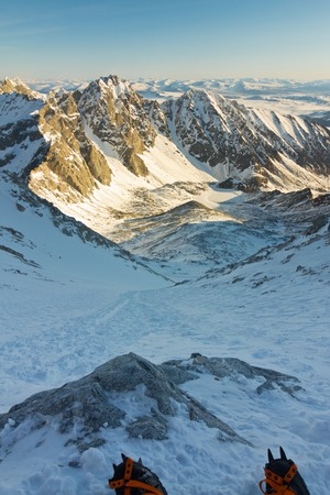 crampon: crampons mountains in the background at sunrise with winter moraine