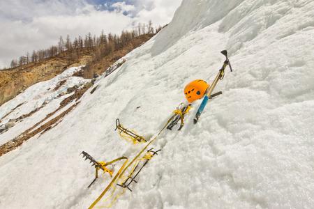 crampon: Homemade new crampons, helmet, ice ax in the snow