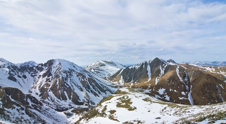 Landscape of the peaks of the Eastern Sayan in the snow