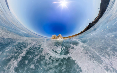 baical: Spherical Panorama Shaman Rock or Cape Burhan on Olkhon Island in winter, surrounded by the blue ice of Lake Baikal with cracks Stock Photo