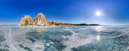 baical: Panorama 360 degree Shaman Rock or Cape Burhan on Olkhon Island in winter, surrounded by the blue ice of Lake Baikal with cracks.
