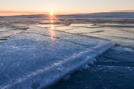 hummock: textured tile blue ice hummock of Lake Baikal at sunset. Olkhon island.