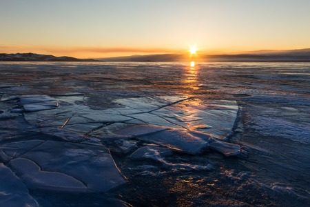 baical: Cracks in the blue ice of Lake Baikal at sunset. Olkhon island.