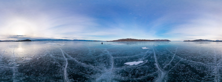 equirectangular: Blue ice of Lake Baikal covered with cracks, cloudy weather sunset.