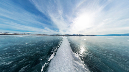 panoramic sky: The road from the big white cracks on the ice of Lake Baikal. The polar panorama. Stock Photo