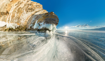 panoramic sky: Rock on Olkhon Island on Lake Baikal ice covered wide-angle panorama.