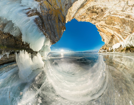 ice covered: Ice grotto in rock on Olkhon Island on Lake Baikal ice covered wide-angle panorama.
