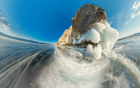 ice covered: Rock on Olkhon Island on Lake Baikal ice covered on aerial fisheye.