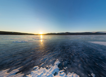 equirectangular: sunrise on the island of Olkhon, snowy spot on the ice of Lake Baikal. Stock Photo