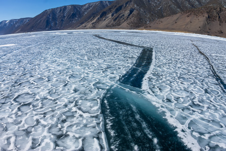 baical: Wide crack in the ice of Lake Baikal. Stock Photo