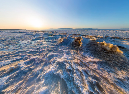 Aerial panorama of snow sunrise wave on the shore of Olkhon. Baikal.