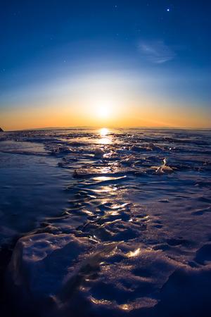 baical: textured tile blue ice hummock of Lake Baikal at moon light. Olkhon island Stock Photo
