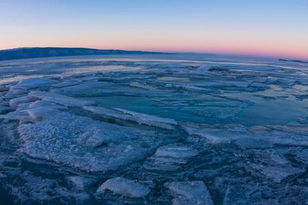 baical: textured tile blue ice hummock of Lake Baikal at sunset. Olkhon island.
