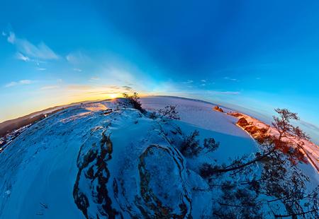 Aeropanorama sunset rock shaman on the island of Olkhon in winter