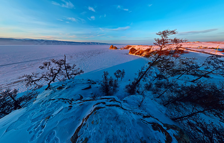 Wide aerial Shaman rock cape at dawn on the island of Olkhon, Lake Baikal.