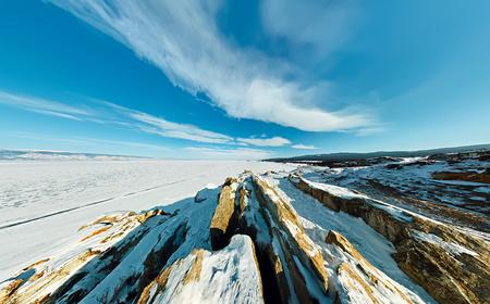 Wide aerial Shaman rock cape at dawn on the island of Olkhon, Lake Baikal.