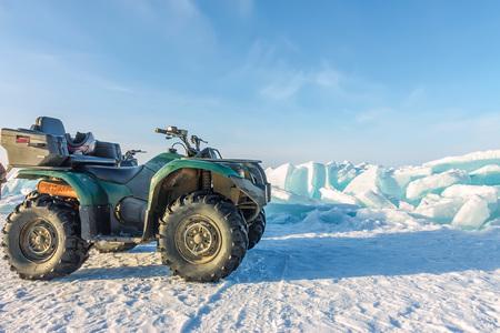 Quad bike on the ice bikala among hummocks.