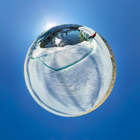 Spherical 360 180 panorama of a man on an ice melting river.