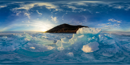 Woman in blue hummocks of the ice Baikal at sunset. Spherical vr 360 180 degrees panorama. Foto de archivo