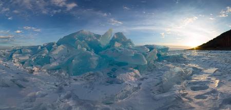Panorama of the blue hummocks of Lake Baikal at sunset.