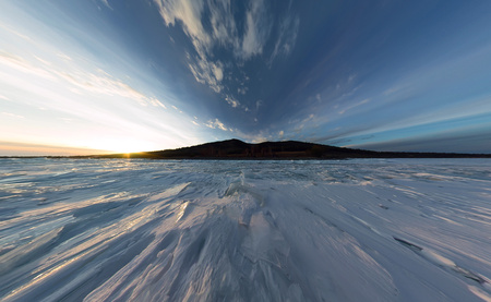 Panorama of the snow of Lake Baikal during sunset. Фото со стока