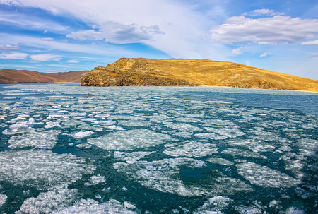 Lake Baikal in spring. View of the ice drift in the small sea from the coastal rocks.