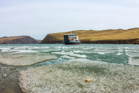 Spring melting ice of Lake Baikal, ferry crossing Olkhon gate. Фото со стока