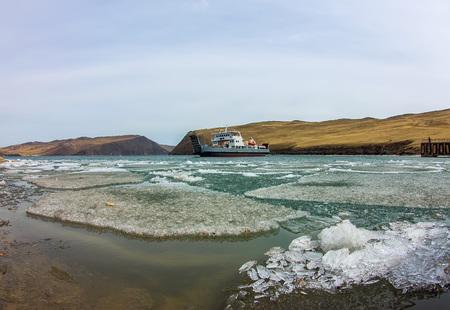 Spring melting ice of Lake Baikal, ferry crossing Olkhon gate. Фото со стока