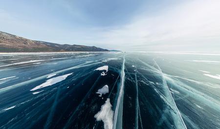 Panorama cracks on blue ice of Lake Baikal from Olkhon.
