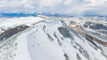 Snowy mountains aero photo drone, clouds approaching peaks and valley. Фото со стока - 102203866