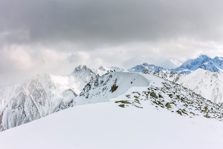 Snowy mountains aero photo drone, clouds approaching peaks and valley. Фото со стока - 102216144