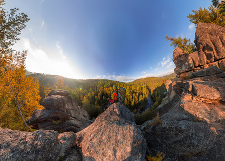 Backpacker on top of a rock fall at dawn. Wide angle aerial panorama. Фото со стока - 103168494