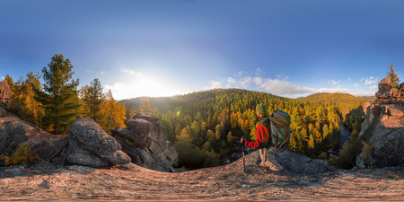 Backpacker on top of a rock fall at dawn. Spherical panorama 360 180 degrees equidistant. Фото со стока - 102486307