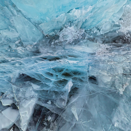 Background ice blue crystal clear lake covered with cracks. Фото со стока - 102914989