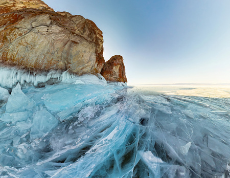 rock in the ice of Lake Baikal, the island of Olkhon. Panorama landscape, abstraction. Stock Photo