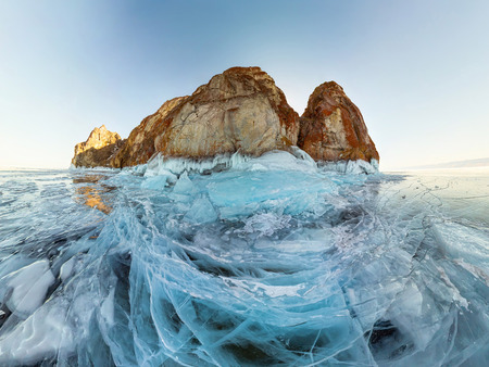 rock in the ice of Lake Baikal, the island of Olkhon. Panorama landscape, abstraction. Фото со стока - 102899082