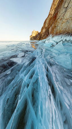 rock in the ice of Lake Baikal, the island of Olkhon. Panorama landscape, abstraction. Фото со стока - 102875166