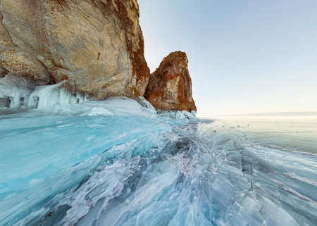 rock in the ice of Lake Baikal, the island of Olkhon. Panorama landscape, abstraction. Фото со стока - 102875170