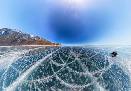 Patterns of cracks on a blue winter ice of Lake Baikal from Olkhon Фото со стока - 105590026